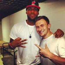 Manziel hanging with LeBron James and throwing up some pretty gangster hand signs yo!
